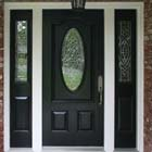We replaced this plain wihte farm door with an elegant energy effecient entry door system with triple pane glass.