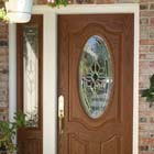 This old white door was replaced with a wood grain solid core fiberglass entry door system with triple pane glass.