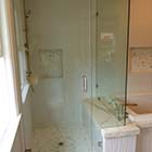 Able Glass installed a heavy glass frameless shower enclosure with brushed nickel clips, hinges, and back-to-back c-pull.  This is a door with inline panel and 90° return.