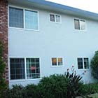 Able Glass changed these window old, single pane, aluminum, and drafty windows in this apartment complex to energy efficient, double pane, Milgard white Styleline™ Series vinyl windows.