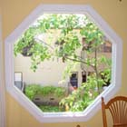 We replaced this old single pane bronze aluminum window with an AMSCO white interior vinyl retro-fit window.
